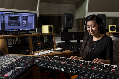Music Engineering student working in the lab